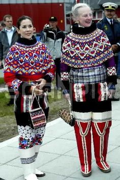 Queen Margarethe and Crown Princess Mary of Demark wearing the national dress of Greenland and Faroe Island.