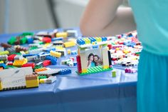 Awesome party craft idea: DIY Lego photo frames using Mini polaroids taken at the party