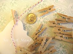 Mini clothes pins to clip mini banner on twine