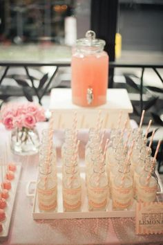 Pink lemonade station at Parisian themed party