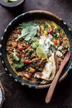 COCONUT QUINOA AND LENTIL CURRY WITH LIME MANGO 20 Lentil Recipes to Make for Breakfast, Lunch and Dinner #purewow #breakfast #lunch #dinner #recipe #easy #food #vegetarian #vegetarianrecipes #easyvegetarianmeals #vegetariandinners #lentilrecipes #quinoa