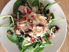 Chicken mushroom risotto on a bed of spinach