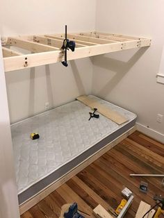 How To Make DIY Built-In Bunk Beds Young house loveSee how we constructed built-in bunk beds including ladders and railings by building simple floating platforms for two XL double mattresses.Tutorial for floating bunk beds {cancel Bunk Beds For Girls Room, Bunk Beds For Boys Room, Bunk Beds Built In, Modern Bunk Beds, Bunk Beds With Stairs, Bunk Rooms, Kid Beds, Built In Beds For Kids, Build In Bunk Beds