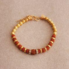 Find Striking Rudraksha Bracelet rakhi on nominal price here! Gold Chain Design, Gold Bangles Design, Bracelet Designs, Necklace Designs, Polymer Clay Embroidery, Handmade Rakhi, Rakhi Design, Mens Gold Jewelry, Bead Jewellery