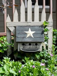 Picket Fence as a decoration/wall.   A fence that is NOT a fence.....Smile :)  Cute idea to mount the birdhouse on the gate = Meeting Annie Steen | Flea Market Gardening