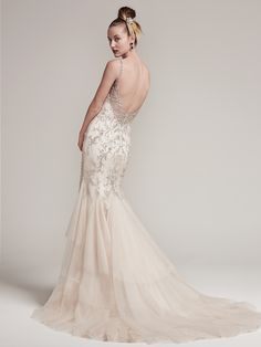 The Erin is dramatic and Romantic, and for the bride who knows how to steal the show