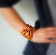 Today's DIY is a really cute and fashionable leather bow bracelet that is also super simple to make! What more can you ask for?