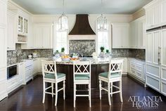 Love the backsplash. Kitchen ivory cabinets with dark hardwood floors and blue ceiling painted in Rhine River by Benjamin Moore. Mallory Mathison Inc. Atlanta Homes & Lifestyles. Kitchen On A Budget, Kitchen Dining, Kitchen Decor, Ivory Kitchen, Kitchen Cabinets, Nice Kitchen, Condo Kitchen, Kitchen Backsplash, Kitchen Ideas