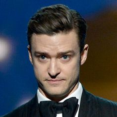 JT's slick hair with a side part is perfect for any wedding or black tie event.