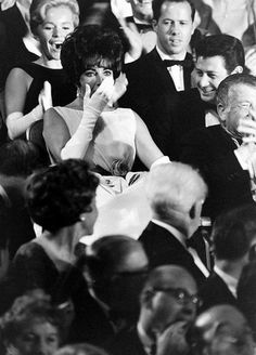 Elizabeth Taylor hearing the announcement of her win of her first Oscar for best actress for Butterfield-8, at the 33rd Academy Awards, 1961.