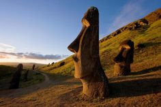 Picture of giant monolithic stone moai statues on Easter Island - National Geographic Parc National, National Parks, Easter Island Moai, Easter Island Statues, National Geographic Travel, Argentine, Travel News, Travel Trip, Solo Travel