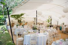 Image by Especially amy - A back garden wedding in surrey with Alan Hannah gown & pastel highstreet bridesmaid dresses. English Country Garden theme with Stretch tent marquee.