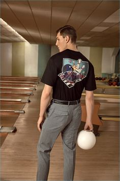 Going bowling, Luke Farley sports a Prada graphic tee and trousers.