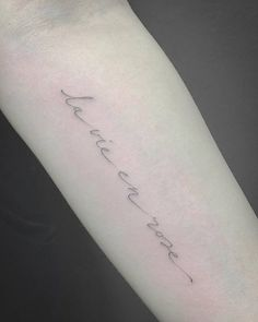 La vie en rose tattoo on the left inner forearm....