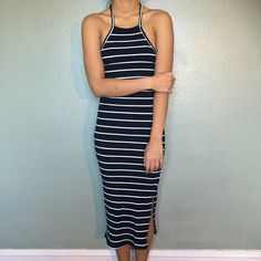 Casual strip dress Adorable halter top navy blue thick strip with thin white strip. (The blue almost looks black, fyi) stretchy and comfortable. Has a slit on the bottom & an open back. Model is 5'2 104lbs and still extra room since it stretches brand new. ALSO AVAILABLE IN A SIZE SMALL IN OLIVE GREEN Dresses Midi
