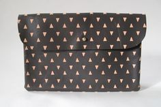 falcon wright black clutch with peach triangles in leather