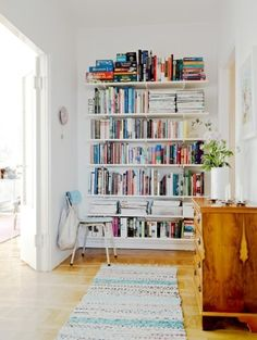 shelves Bright and Unique Scandinavian Apartment Interior Decorating : White Wall Mounted Shelf And Wood Floor In Library Design Apartment Interior, Apartment Design, Apartment Therapy, Berlin Apartment, Home Living, Living Spaces, Living Room, Sweet Home, Scandinavian Apartment