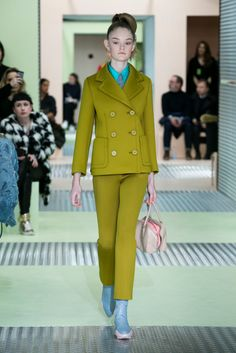 Miuccia Prada's double-breasted pantsuit, in a spongy, stretch fabric, had a Claymation effect. (Photo: Nowfashion)
