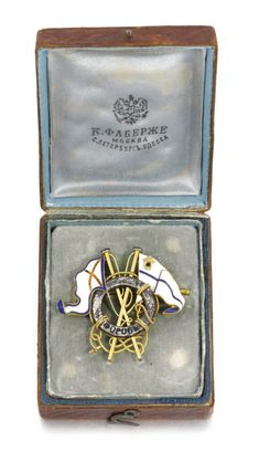 THE YACHT 'FOROS': A FABERGE SILVER, GOLD AND ENAMEL BADGE, WORKMASTER OSCAR PIHL, MOSCOW, CIRCA 1895 the silver life-belt with the enamel caption 'Foros' entwined with gilt ropes and two flags enamelled in opaque blue, white and red, struck with workmaster's initials, 56 standard, in original Fabergé fitted leather case.