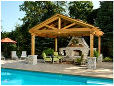 Outside fireplace and undercover entertainment area by pool side. Ref: http://www.houzz.com