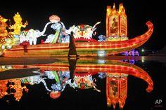 "AP Images on Twitter ""A woman walks past an illuminated decoration symbolizing Thailand in Kuala Lumpur, Malaysia. #APPhoto by Joshua Paul"""