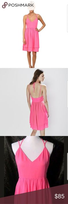 "Rebecca Minkoff Belinda Dress Beautiful pink silk dress. Halter and spaghetti straps. Tiered skirt. Zipper side. Some snags around bust area.  Armpit to armpit approximately 16"" Shoulder to hemline approximately 39"" Waist approximately 15"" All measurements taken while garment was flat. Rebecca Minkoff Dresses"