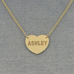 This Personalized 18K Gold Plated Name Engraved Heart Charm Necklace is the perfect gift for anytime of the year. Select any name or initials of your choice to be engraved on this special heart charm pendant, which is beautifully crafted by solid Sterling Silver coming with the sturdy Rollo chain. This name engraved pendant in fine quality Sterling Silver is cut out by latest technology laser machine with top quality guaranteed and high polished finish. All the letters are capitalized.