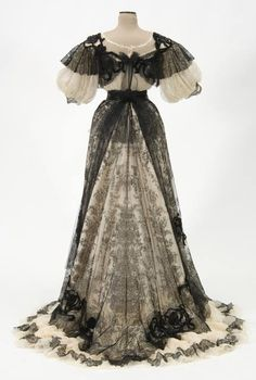 Evening dress of silk chiffon over white satin and sequined black Chantilly lace. Made by dressmaker, Mrs. George F. Hall, Chicago, Illinois, circa 1905. The lace made in Geraardsbergen.      back