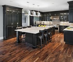 """Marchvale Kitchen by Laurysen Kitchens Ltd. Nothing spells """"classy"""" like the color black! Black is essentially a timeless color, like a black dress or tuxedo. Decked out with the latest stainless steel appliances, this black kitchen shows a high level of sophistication and can easily be any homeowner's dream. Off white marble countertop and a white ceiling balance cool grey walls and dark ebony cabinets"""