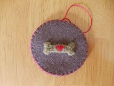 Needle Felted Dog Biscuit With Heart On Brown Felt by Sita802