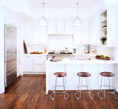 White Transitional Kitchen With Chevron Tiles and Walnut Stools // Designer Crush: Alison Davin
