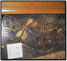 Dragonfly Back Splash - mosaic by Agnieszke Cukrowski - Artist lives in London, Ontario, Canada - this site is filled with her work and links to her gallery!  Amazingly talented artist.