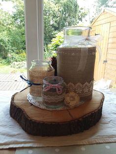 Vintage wedding hesian and lace jars