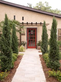 America's Most Desperate Landscape 2014 Inviting Red Door  http://www.diynetwork.com/decorating/americas-most-desperate-landscape-2014-before-and-after-pictures/pictures/index.html?soc=pinterest