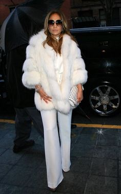 Jennifer lopez, fendi jumpsuit and white fur coat and studded clutch... AMAZING!