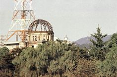 A stainless steel Buddhist pagoda, a memorial for victims, built in 1966 can be seen on August 6, 1970. The pagoda enshrines Buddha's ashes dedicated by Ceylonese Buddhist association. Concrete section was burnt and melted, leaving a steel frame when the atomic-bomb exploded above the dome, August 6, 1945. The dome was a majestic piece of architecture before the bombardment. It's the only building allowed to stand. The dome is preserved as a grim reminder of that tragic moment. (AP Photo)