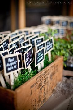 Table assignments in grass planted in wine crates