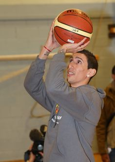 Angel Di Maria tries his hand at Basketball during a visit to Burnage Academy for Boys as part of the Premier League 4 Sport initiative, supported by the @manutd Foundation.