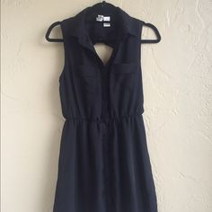 Open back black button dress Great black dress has an open back and buttons up the front. Made of a chiffon fabric. Some light wear. Size medium but fits like a small Mimi Chica Dresses Midi