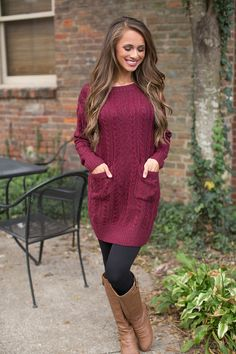 This cozy sweater tunic is sure to become your new favorite piece for fall and winter! Featuring a thick and soft knit material in a classic shade of wine, this look is so classically cozy for the season!
