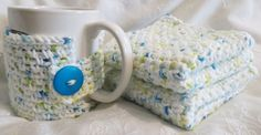 This is a crocheted mug cozy and two wash cloths matching set.   I crocheted these in 100% cotton yarn.    The color is white with yellow, green and blue flecks.   The mug cozy was made to fit a  mug