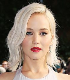 Jennifer Lawrence's white-blonde hair and bright red lips are so perfect