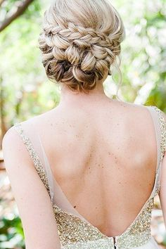 We love this braided updo! #wedding ideas #wedding hairdos #hawaiiprincessbrides