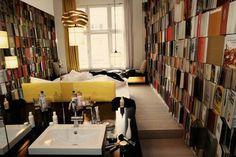 Michelburger Hotel Berlin. ..eclectic book lines walls