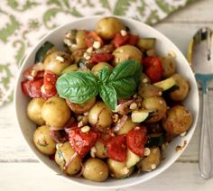 Farmers Market Potato Salad - A light, fresh potato salad made with zucchini, tomatoes and corn and topped with a simple homemade balsamic dressing. Only 105 calories a serving!