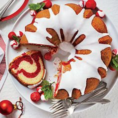 A simple Snowy White Vanilla Glaze graces the top of our Red Velvet Marble Bundt Cake.