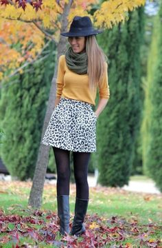 Mustard top, animal print skirt, infinity scarf, black tights & boots