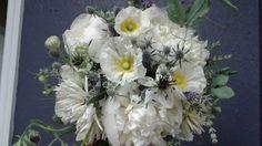 Spring bridal work: lavender, dahlias, sweet peas, peonies, poppies, seas holly, nigella.