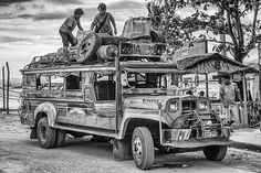 Packing the bus in Sabang harbour, Palawan, Philippines