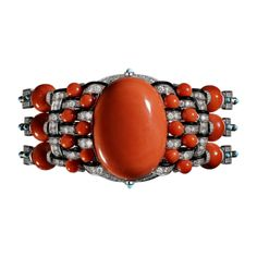 Bracelet Haute Joaillerie Bracelet Corallin, platine, un corail ovale taille cabochon de 36,42carats, douze boules corail pour 37,51carats, boules corail, turquoises taille cabochon, onyx, diamants taille brillant.